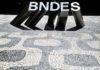 Antecipação do BNDES e venda de reservas puxaram queda