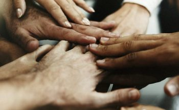 cropped-closeup-diverse-people-joining-their-hands-scaled-1.jpg